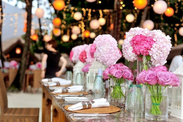 A group of pink flowers on a table
